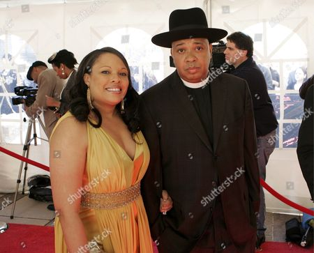 Rock and Roll Hall of Fame Inductee One of the Founding Members of Hip Hop Group Run-d M C Joseph 'Reverend Run' Simmons (r) and His Wife Justine Simmons (l) Arrive at the Rock and Roll Hall of Fame Induction Ceremony in Cleveland Ohio Usa 04 April 2009 This Year's Inductees Are Jeff Beck Bill Black Dj Fontana Wanda Jackson Little Anthony and the Imperials Metallica Run-d M C Spooner Oldham and Bobby Womack
