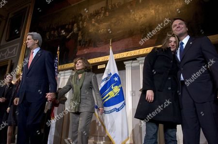 Stock Photo of Democratic Candidate For United States President John Kerry (l) and His Wife Teresa Heinz Kerry (2-l) Stand On Stage with (r) Running Mate John Edwards and His Daughter Kate Edwards (2-r) After Kerry Gave Their Concession Speech at Fanueil Hall in Boston Massachusetts Wednesday 03 November 2004 the Kerry Campaign Conceded After a Tight Race Following Election Results in the State of Ohio -