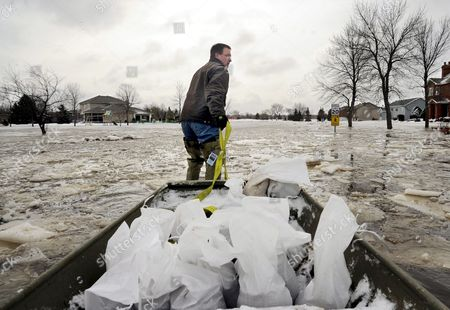 Stock Picture of Todd Thompson of Barnesville Minnesota Pulls a Boat Load of Sandbags to a Friend's House in Oxbow North Dakota Usa 26 March 2009 Oxbow is a Town South of Fargo North Dakota Residents Scrambled to Pile Sandbags and Build Dikes As North Dakota Braced For the Arrival of What Forecasts Say Could Be the Biggest Flood in 100 Years