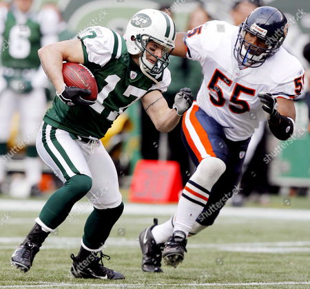The Jets' Tim Dwight (l) Tries to Get Past the Bears' Lance Briggs (r) During the First Half of the Game Between the Chicago Bears' and the New York Jets at the Meadowlands in East Rutherford New Jersey On Sunday 19 November 2006
