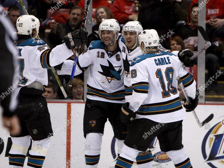 San Jose Sharks Jeremy Roenick (l) Patrick Marleau Devin Setoguchi and Matt Carle (r) Celerates Setoguchi Goal Against the Detroit Red Wings During the Third Period at Joe Louis Arena in Detroit Michigan Usa On 29 February 2008 the Sharks Beat the Red Wings 3-2