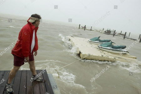 As Hurricane Rita Begins Lashing the Florida Keys Hotel Employee Paul Simmons Watches As the Storm Tears Loose a Floating Dock in Islamorada United States Tuesday 20 September 2005 the Storm Was Updated to a Category One Hurricane Tuesday Morning and Expected to Continue Strengthening