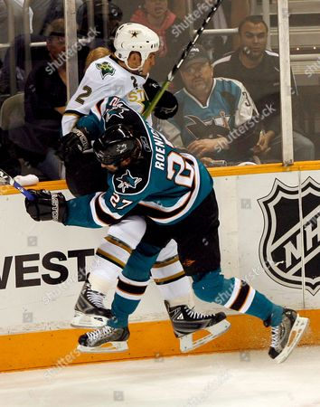 San Jose Sharks Center Jeremy Roenick (r) Checks Dallas Stars Defenseman Nicklas Grossman (l) of Sweden During the Third Period of Game 5 of the Western Conference Semi-final Playoffs at Hp Pavilion in San Jose California Usa 02 May 2008 the Sharks Defeated the Stars 3-2 in Over-time