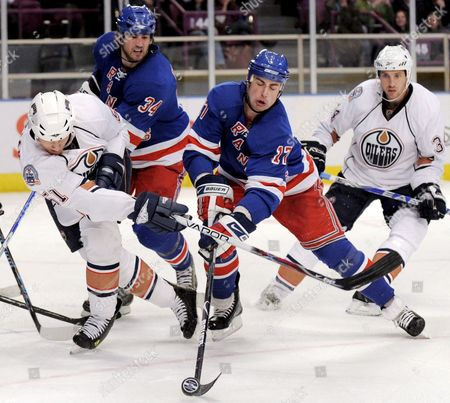 The Rangers' Brandon Dubinsky (2nd R) and Aaron Voros (2-l) Battle For the Puck with the Oilers' Kyle Brodziak (l) and Fernando Pisani (r) During the Second Period of the Game Between the Edmonton Oilers and New York Rangers at Madison Square Garden in New York New York Usa On 10 November 2008