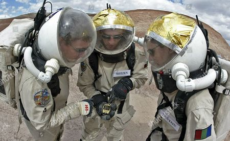 Phil Larson (l) of Aerospace Studies Eva Commander Jeremy Sotzen (c) of Aeronautical University and Mike Fenton (r) of Penn State University Look Over Gps Data As They Explore the Utah Desert Near the Mars Desert Research Station Northwest of Hanksville Utah Monday 08 May 2006 the Station Located in the Utah Desert is Run by the Mars Society and is Used to Practice Living and Working On Mars Crews Usually Have a Two Week Stay at the Station