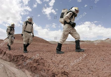 Eva Commander Jeremy Sotzen (r) of Aeronautical University Phil Larson (c) of Aerospace Studies and Mike Fenton (l) of Penn State University Walk Through the Utah Desert Near the Mars Desert Research Station Northwest of Hanksville Utah Monday 08 May 2006 the Station Located in the Utah Desert is Run by the Mars Society and is Used to Practice Living and Working On Mars Crews Usually Have a Two Week Stay at the Station