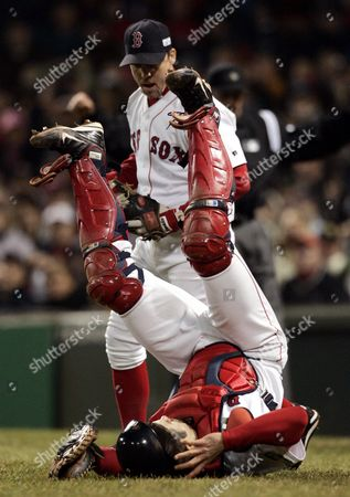 Boston Red Sox Catcher Jason Varitek (bottom) is Upended After Colliding with Third Baseman Bill Mueller As They Tried in Vain to Catch a Foul Ball Off the Bat of St Louis Cardinals Batter Jim Edmonds in the Second Inning of Game Two of the World Series at Fenway Park in Boston Massachusetts Sunday 24 October 2004 the Red Sox Lead the Best-of-seven Series 1-0