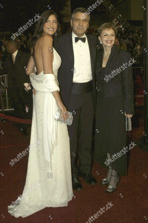 Actor George Clooney (c) Poses For Photographers with His Mother Nina Warren (r) and Girlfriend Model Lisa Snowden (l) For the Premiere of His New Film 'Ocean's Twelve' at the Chinese Theatre in the Hollywood Section of Los Angeles Wednesday 08 December 2004