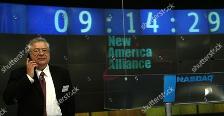 New American Alliance Chairman of the Board Moctesuma Esparza Talks On His Cell Phone Before the Ring of the Opening Bell at the Nasdaq Friday 24 October 2003 New Alliance is an Organization of American Latino Business Leaders United to Promote the Economic Advancement of the American Latino Community