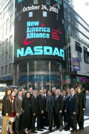 New American Alliance Chairman of the Board Moctesuma Esparza Poses with His Employees Outside in Time Square After the Ring of the Opening Bell at the Nasdaq Friday 24 October 2003 New Alliance is an Organization of American Latino Business Leaders United to Promote the Economic Advancement of the American Latino Community