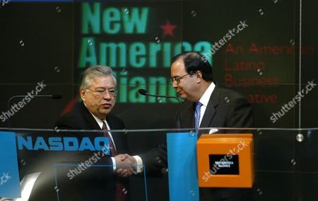 New American Alliance Chairman of the Board Moctesuma Esparza (l) Shakes Hands with the Nasdaq Host Executive Vice President Ed Knight (r) Before the Ringing of the Opening Bell at the Nasdaq Friday 24 October 2003 New Alliance is an Organization of American Latino Business Leaders United to Promote the Economic Advancement of the American Latino Community