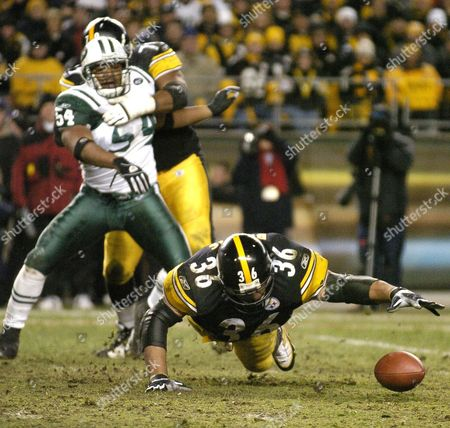 Victor Hobson (l) of the New York Jets Watches As Jerome Bettis (r) of the Pittsburgh Steelers Fumbles the Ball During the Fourth Quarter at Heinz Field in Pittsburgh Pennsylvania During Their Afc Divisional Playoff Game On Saturday 15 January 2005 the Jets Recovered the Fumble But the Steelers Defeated the Jets 20-17 in Overtime United States Pittsburgh