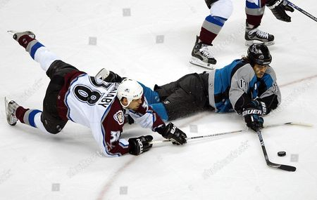 Stock Picture of Colorado Avalanche Matthew Barnaby (l) Trips Up San Jose Sharks Todd Harvey (r) During Game Two of the Western Conference Playoffs at Hp Pavilion in San Jose California Saturday 24 April 2004 Barnaby Was Called For a Penalty