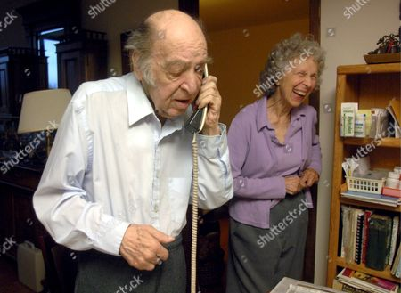 Leonid Hurwicz of the University of Minnesota Talks On the Phone with Well Wishers While His Wife Evelyn Looks On After It Was Announced He Won the Nobel Prize in Economics at His Home in Minneapolis Minnesota Usa 15 October 2007 Hurwicz Shares the Nobel Prize in Economics with Roger Myerson and Eric Maskin 'For Having Laid the Foundations of Mechanism Theory'