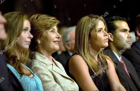 Stock Image of Us First Lady Laura Bush (2nd L) and Her Daughters Jenna (2nd R) and Barbara (l) and George P Bush (r) Nephew of the President Watch the Final Televised Presidential Debate Between Us President George W Bush and United States Senator John Kerry at Arizona State University in Tempe Arizona Wednesday 13 October 2004