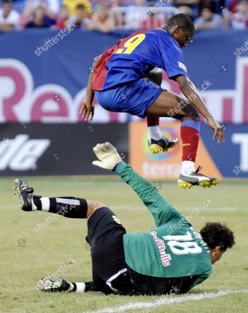 Barcelona's Samuel Eto'o Jumps Over the Red Bulls' Goalkeeper Jon Conway After Scoring During the First Half of the Game Between the New York Red Bulls and Fc Barcelona As Part of Fc Barcelona's Tour of the United States at Giants Stadium in East Rutherford New Jersey Usa 06 August 2008 Barcelona Won 6-2