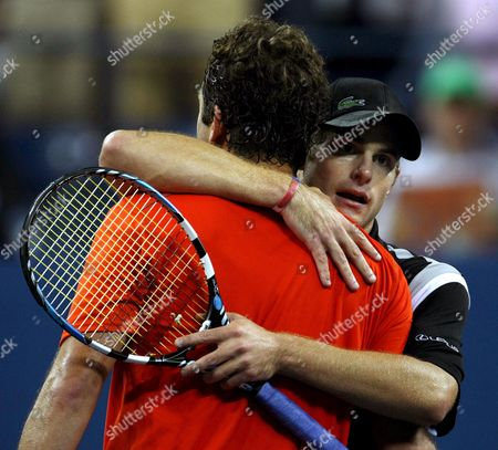 Andy Roddick of the Us (r) Embraces Justin Gimelstob of the Us at the Net After Their First Round Match On the Second Day of the 2007 Us Open Tennis Tournament in Flushing Meadows New York Usa 28 August 2007 Roddick Defeated Gimelstob 7-6 (8) 6-3 6-3