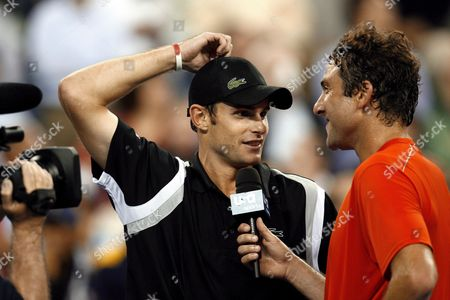 Andy Roddick of the Us (l) is Interviewed by Justin Gimelstob of the Us at the Net After Their First Round Match On the Second Day of the 2007 Us Open Tennis Tournament in Flushing Meadows New York Usa 28 August 2007 Roddick Defeated Gimelstob 7-6 (8) 6-3 6-3