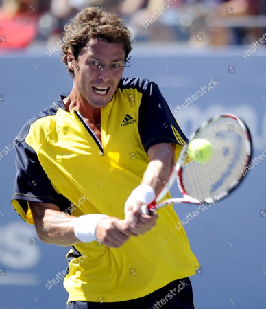 Marat Safin of Russia Hits a Backhand Return to Vincent Spadea of the Us During Their First Round Match On the Second Day of the 2008 Us Open Tennis Tournament in Flushing Meadows New York Usa On 26 August 2008