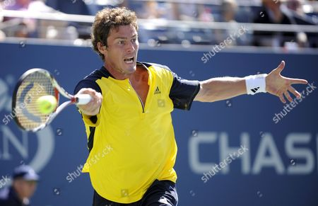 Marat Safin of Russia Hits a Forehand Return to Vincent Spadea of the Us During Their First Round Match On the Second Day of the 2008 Us Open Tennis Tournament in Flushing Meadows New York Usa On 26 August 2008