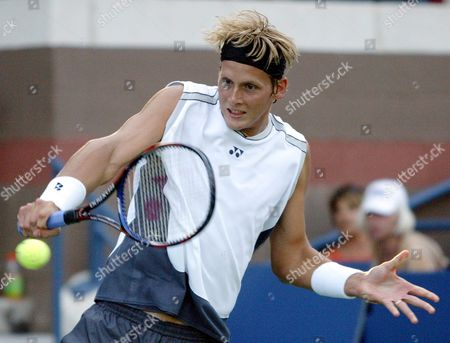 Joachim Johansson of Sweden Hits a Backhand Return to Jan-michael Gambill of the Us During Their Second Round Tennis Match at the Us Open in Flushing Meadows New York Friday 03 September 2004
