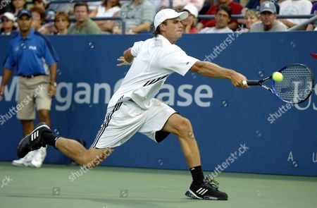 Jan-michael Gambill of the Us Reaches For a Backhand Return to Joachim Johansson of Sweden During Their Second Round Tennis Match at the Us Open in Flushing Meadows New York Friday 03 September 2004