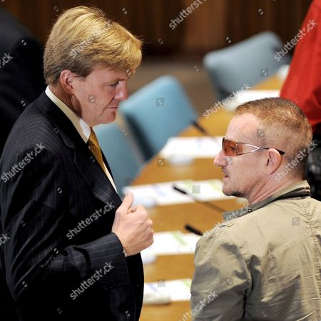 Stock Picture of Prince Willem-alexander (l) the Prince of Orange Netherlands and Musician Bono (r) Talk at the Start of a Round Table Discussion About Education and Health During the General Debate of the 63rd Session of the United Nations General Assembly at United Nations Headquarters in New York New York Usa On 25 September 2008
