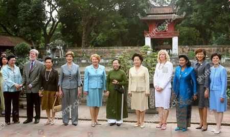 The Spouses of Some of the Asia Pacific Economic Cooperation (apec) Nation Leaders Pose For a Group Photo As They Walk Through the Temple of Literature and National University a Symbol of Confucianism and Highly Significant Cultural and Historical Monument in Hanoi Vietnam Saturday 18 November 2006 (l-r) Mrs Chang From Chinese Taipei Peter Davis From New Zealand Chitrawadee Chulanont From Thailand United States First Lady Laura Bush Janette Howard From Australia Tran Thi Kin Chi Wife of the President of Vietnam Mrs Roh Moo-hyun From South Korea Laureen Harper From Canada Ani Susilo Bambang Yudhoyono From Indonesia Akie Abe From Japan and Mrs Tsang Wife of Hong Kong Chief Executive Donald Tsang