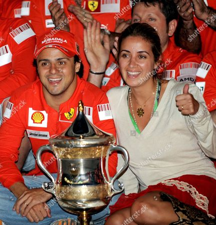 Brazilian Formula One Driver Felipe Massa (l) of Ferrari and His Wife Rafaela Bassi (r) Pose Behind of the Trophy After He Won the Bahrain Grand Prix at the Sakhir Circuit Near Manama Bahrain On 06 April 2008
