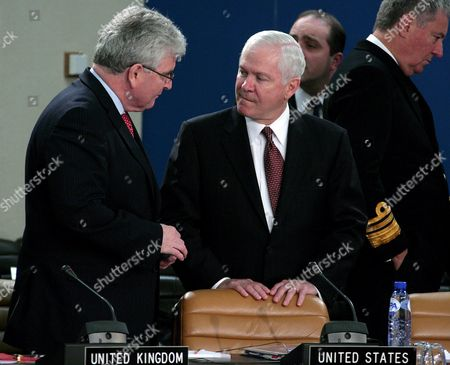 British Defence Secretary Des Browne (l) Chats with Us Defence Secretary Robert Gates (r) During a Nato Defence Ministers Meeting at Nato Headquarters in Brussels 13 June 2008 Nato Defense Ministers Agreed That the Alliance Should Train Kosovo's Future Security Force Despite Disagreeing On the Region's Status Three Days Before Kosovo's Constitution is Due to Come Into Effect the 26-member Alliance Had Been Deadlocked Over the Plan Laid out in 2007 by Un Special Envoy Martti Ahtisaari For Nato to Train the Kosovo Security Force (ksf) Because Several Members Including Spain Slovakia and Romania Had Refused to Recognize Kosovo's Independence