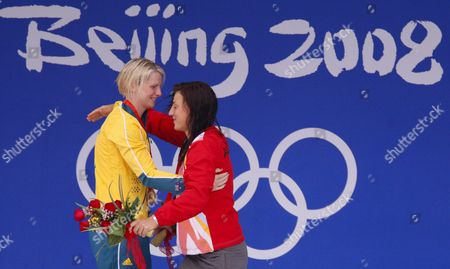 Australian Swimmer Leisel Jones (l) and Mirna Jukic From Austria Hug Each Other After the 100m Breaststroke Final at the 2008 Olympics at the National Aquatics Center in Beijing China 12 August 2008 China Beijing