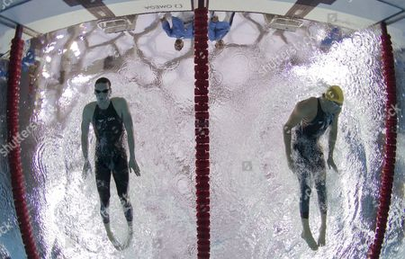 Grant Hackett of Australia (r) and Ryan Cochrane of Canada (l) at the Turn in the Men's 1500m Freestyle in the Swimming at the Beijing 2008 Olympic Games in the National Aquatics Center Beijing China 17 August 2008 Hackett Won Silver and Cochrane Bronze China Beijing