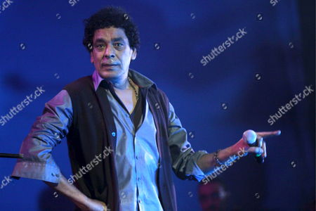 Stock Picture of Egyptian-nubian Musician Mohammed Mounir Performs with Spanish Singer Maria Bonet Del Mar (not Seen) During a Concert Held at the Opera House in Cairo Egypt On 03 March 2009 Which Aimed at Reinforcing the Role of Culture in Rebuilding Spaces For Dialogue and Mutual Understanding Across Europe and the Arab Region the Concert Took Place in the Presence of Benita Ferrero-waldner European Commissioner For External Relations and Amre Moussa Secretary General of the Arab League As Well As Over One Thousand People Including Representatives of Egyptian Civil Society Leading Intellectuals Opinion-makers and Arab Ministers of Foreign Affairs