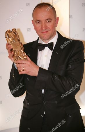 French Director of 'Il Y a Longtemps Que Je T'aime' (i've Loved You So Long) Philippe Claudel Holds His Trophy For Best First Film During a Photocall After the 34th Cesar Awards at the Theatre Du Chatelet in Paris France 27 February 2009 the Cesar Award is the National Film Award of France First Given out in 1975 the Nominations Are Selected by the Members of the Academie Des Arts Et Techniques Du Cinema
