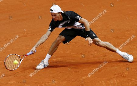 Guillermo Coria of Argentina Returns to Tommy Robredo of Spain During Their First Round Match For the French Open Tennis Tournament at Roland Garros in Paris France 26 May 2008