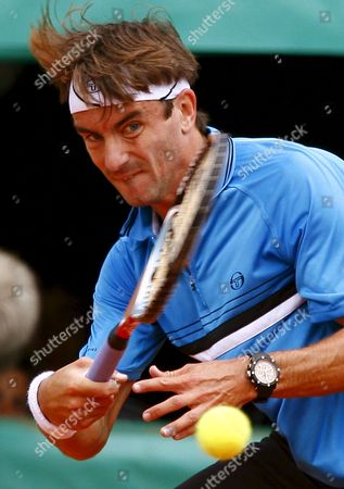 Tommy Robredo of Spain Returns to Guillermo Coria of Argentina During Their First Round Match For the French Open Tennis Tournament at Roland Garros in Paris France 26 May 2008