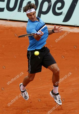 Tommy Robredo of Spain Returns to Guillermo Coria of Argentina in Their First Round Match For the French Open Tennis Tournament at Roland Garros in Paris France 26 May 2008