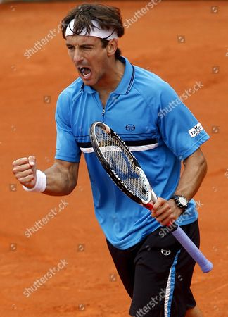 Tommy Robredo of Spain Celebrates His Victory Over Guillermo Coria of Argentina in Their First Round Match For the French Open Tennis Tournament at Roland Garros in Paris France 26 May 2008