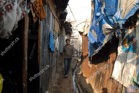 Rafiq Qureshi Father of Child Actor in Slumdog Millionaire'' Rubina Ali Qureshi Walks to His Home at Slum in Mumbai India 23 February 2009 the Mumbai-based Movie About the Unlikely Rise of an Inconsequential Indian Pauper to Win India's Most Popular Game Show Won an Even More Remarkable Victory When It Swept Eight Oscars Including the Most Coveted One of All For Best Picture of the Year the Movie Has Already Earned Close to $160 Million at the Global Box Office and the Oscar Win Will Surely Boost Its Earning Significantly
