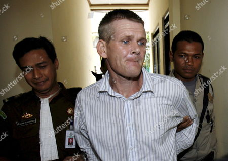 Britian Ronnie Ramsay (c) is Escorted by Police and Prosecutor For His Trial at a Denpasar District Court in Bali Indonesia On 30 August 2007 Ronnie Ramsey is Facing a 14 Month Jail Sentence After Being Allegedly Caught with Small Amount of Heroin in February 2007