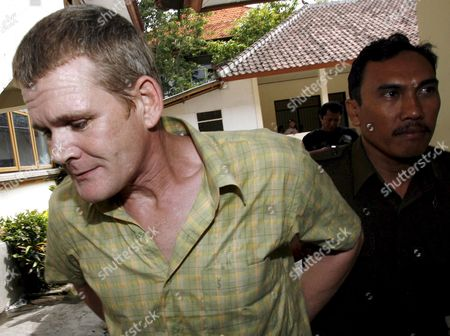 Ronnie Ramsay 39 From Britain the Brother of Celebrity Chef Gordon Ramsay is Escorted by a Court Officer For His Sentence Demand Trial at a Denpasar District Court in Bali Indonesia On 14 August 2007 Indonesian Prosecutors Asked a Court to Sentence Ronnie to 14 Month in Jail Ronnie Wass Arrested in Bali After Being Caught with a Small Amount of Heroin On February 2007