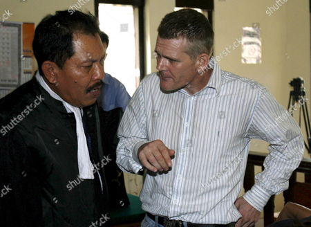 Britian Ronnie Ramsay (r) Talks to His Lawyer Erwin Siregar After His Trial at a Denpasar District Court in Bali Indonesia On 30 August 2007 Ronnie Ramsey is Facing a 14 Month Jail Sentence After Being Allegedly Caught with Small Amount of Heroin in February 2007