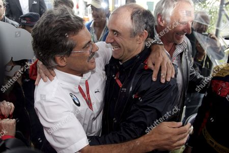 German Dr Mario Theissen (l) Bmw Motorsport Director of Bmw Sauber Hugs Austrian Franz Tost Team Principal of Scuderia Toro Rosso After His Driver Sebastian Vettel Won the Italian F1 Grand Prix Race at the Circuit in Monza Near Milan 14th September 2008