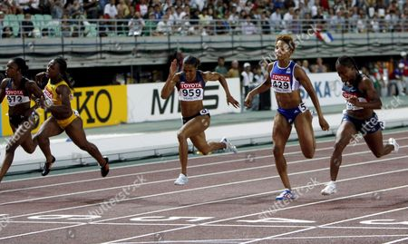 From Left - Carmelita Jeter of Usa Jamaican Veronica Campbell Torri Edwards of the Usa French Christine Arron and Lauryn Williams of the Usa Cross the Finish Line in the Women 100m Race at the 11th Iaaf World Championships in Athletics Osaka Japan 27 August 2007