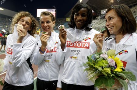 Belgian Sprinters (from Left) Olivia Borlee Hanna Marien Elodie Ouedraogo and Kim Gevaert Pose with Their Bronze Medals During the Podium Ceremony For the Women's 4x100m Relay at the 11th Iaaf World Championships in Athletics Osaka Japan 02 September 2007