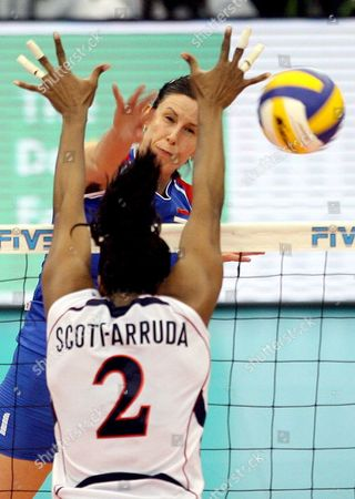 Jelena Nikolic of Serbia (l) Spikes the Ball Past Danielle Scott-arruda of the U S During Their Fourth Round Match at the Fivb Women's Volleyball World Cup in Nagoya Japan On 14 November 2007 Serbia Took the Game 28-26 23-25 25-20 25-23