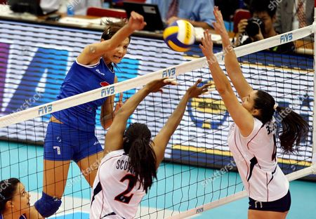 Jelena Nikolic of Serbia (l) Spikes Past Danielle Scott-arruda (2-l) and Lindsey Berg (r) of the U S Tduring Their Fourth Round Match at the Fivb Women's Volleyball World Cup in Nagoya Japan On 14 November 2007 Serbia Took the Game 28-26 23-25 25-20 25-23