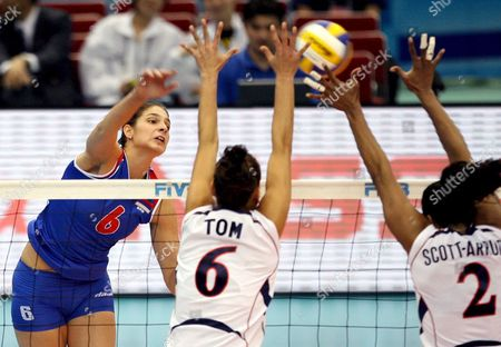 Jovana Brakosevic of Serbia (l) Leaps to Spike the Ball Past Logan Tom (c) and Danielle Scott-arruda of the Usa During Their Fourth Round Match at the Fivb Women's Volleyball World Cup in Nagoya Japan On 14 November 2007 Serbia Took the Game 28-26 23-25 25-20 25-23