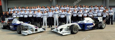 German Formula One Driver Nick Heidfeld (front Row C-l) Director of Bmw Sauber Motorsport Germany's Dr Mario Theissen (front C) and Polish Formula One Driver Robert Kubica (front C-r) of Bmw Sauber Pose For Photographers Together with the Bmw Team Before the First Practice Session at the Sepang Circuit Outside Kuala Lumpur Malaysia 03 April 2009 the 2009 Formula One Grand Prix of Malaysia Will Take Place On 05 April