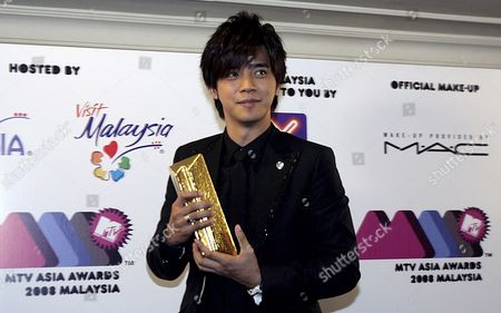 Taiwanese Singer Show Lo Poses with His Trophy For Favourite Artist Taiwan at the Mtv Asia Award in Genting Highlands Outside Kuala Lumpur Malaysia 02 August 2008